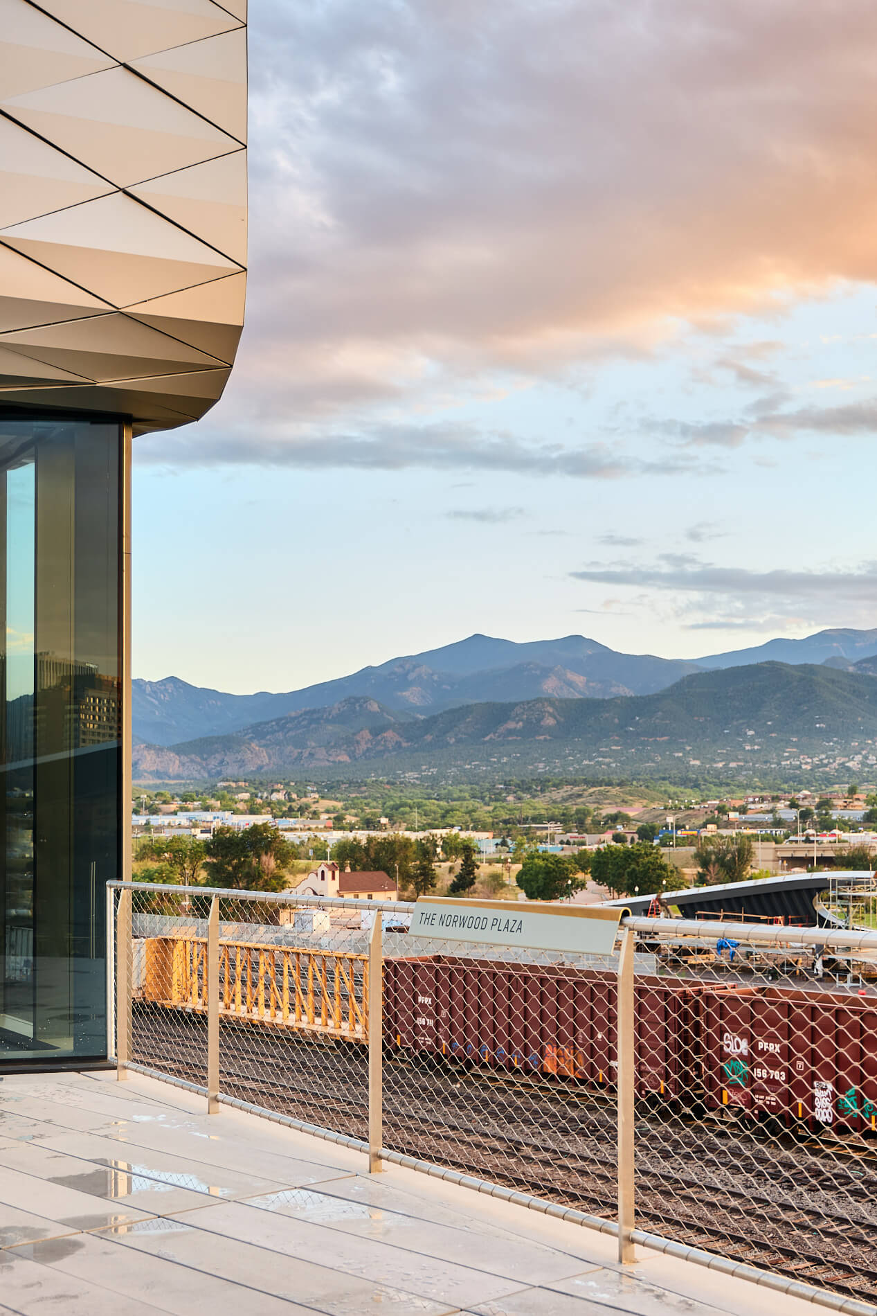 Balcony overlooking a mountain range at sunset